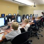 Children working in a computer lab at Saddlebrook Join-Use Facility