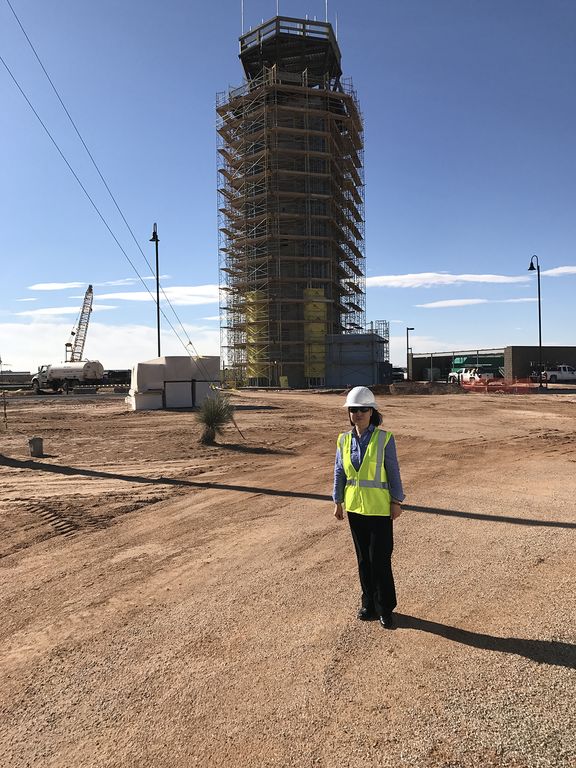 Yumei Wang on the construction site of an air traffic control tower