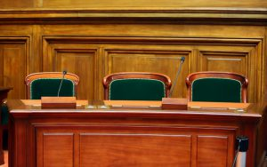 Bench inside a U.S. courtroom.