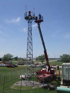IP Design Group staff outfit a beacon at Eppley Airfield to combat the 2011 Missouri River Flood.